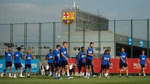 Barcelona team players return for training