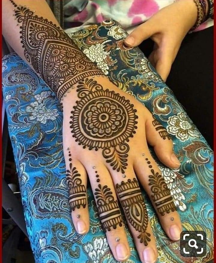 She is Rukash,a very good henna artist and a makeup artist,